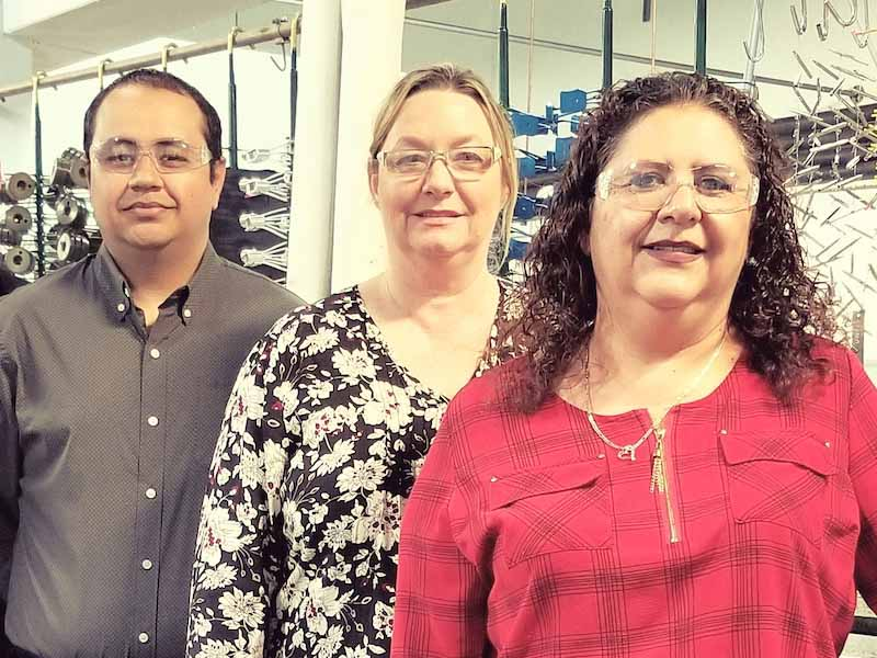 Frank Bautista, production manager; Suzan Russo, general manager; and Rose Bautista, customer service manager.