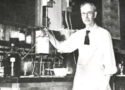 Dr. Oliver P. Watts in his laboratory at the University of Wisconsin.